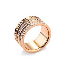 Широкое кольцо в розовой позолоте с гравировкой