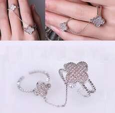 Двойное кольцо клевер в белой позолоте