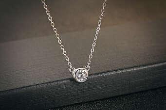Серебряный кулон с серебряной подвеской в ямочку